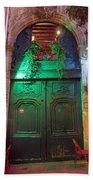 An Old Ornate Wooden Door In Paris France Beach Towel