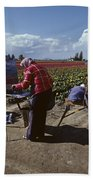 Artists Painting Tulip Fields Standing In A Row  Beach Towel