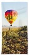 Balloon Ride Over The Desert Beach Towel