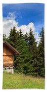 barn on Alpine pasture Beach Towel