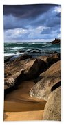 Between Rocks And Water Beach Towel