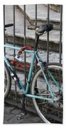 Bicycle Is Chained To A Fence Beach Towel