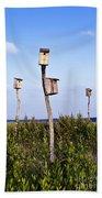 Birdhouses In Salt Marsh. Beach Towel