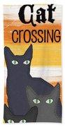 Black Cat Crossing Beach Towel by Linda Woods