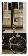 Black Cycle Rests On Window Sill Bruges Belgium Beach Towel