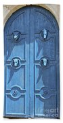 Blue Door Decorated With Wooden Animal Heads Beach Sheet