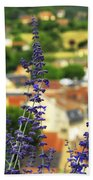 Blue Flowers And Rooftops In Sarlat Beach Towel by Elena Elisseeva
