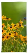 Bluebird Flying Over The Black Eyed Susans Beach Towel