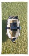 Boat On Ocean Beach Towel by Pixel Chimp