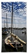 Boat Under The Clouds Beach Towel