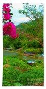 Bouganvilla Watches Over Village Fishing Boats Beach Towel