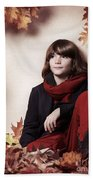 Boy Sitting On Autumn Leaves Artistic Portrait Beach Towel