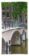 Bridge Over Canal With Bicycles  In Amsterdam Beach Towel