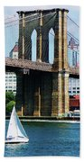 Bridge - Sailboat By The Brooklyn Bridge Beach Towel