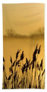 Canada Geese In Flight At Sunrise Beach Towel