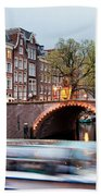 Canal Bridge And Boat Tour In Amsterdam At Evening Beach Towel