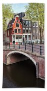 Canal Bridge And Houses In Amsterdam Beach Towel