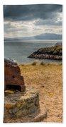 Cannon At Llanddwyn  Beach Towel by Adrian Evans