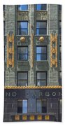 Carbide And Carbon Building Beach Towel by Adam Romanowicz