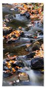 Cascading Autumn Leaves On The Miners River Beach Towel