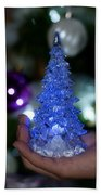 A Christmas Crystal Tree In Blue Beach Towel