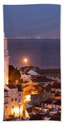 City Of Lisbon In Portugal At Night Beach Sheet
