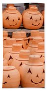 Clay Pumpkins Standing Happy Near The Wood Fence Beach Towel