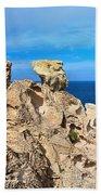 cliff in San Pietro island Beach Towel