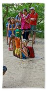 Climbing Down The Ladder Into A Kiva At Spruce Tree House In Mesa Verde National Park-colorado Beach Towel
