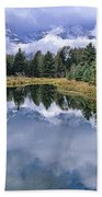 Cloudy Reflection Beach Towel