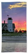 Cocktail Hour At Sandy Neck Lighthouse Beach Towel by Charles Harden
