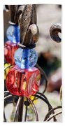 Colorful Glass And Metal Garden Ornaments Beach Towel