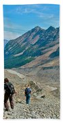 Couple Hiking On Plain Of Six Glaciers Trail  In Banff Np-albert Beach Towel