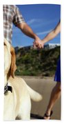 Couple Take Their Dogs For A Walk Beach Towel