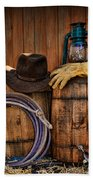 Cowboy Hat And Bronco Riding Gloves Beach Towel by Paul Ward