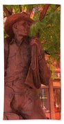 Cowboy Statue In Front Of The Brown Palace Hotel In Denver Beach Towel
