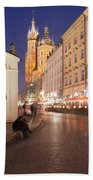 Cracow By Night In Poland Beach Towel