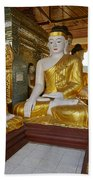 different sitting Buddhas in a circle in SHWEDAGON PAGODA Beach Towel