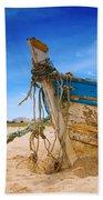 Dilapidated Boat At Ferragudo Beach Algarve Portugal Beach Towel
