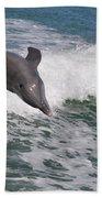 Dolphin Riding The Waves Beach Towel