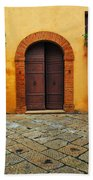 Door And Flowers In A Tuscan Courtyard Beach Towel