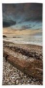 Driftwood Laying On The Gravel Beach Beach Towel