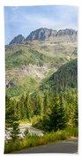 Driving Through Glacier National Park Beach Towel