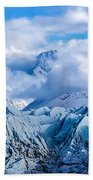 Embraced By Clouds Beach Towel