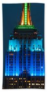 Empire State Building Lit Up At Night Beach Towel