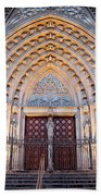 Entrance To The Barcelona Cathedral At Night Beach Towel
