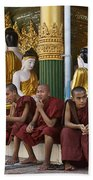 faithful Buddhist monks siiting around Buddha Statues in SHWEDAGON PAGODA Beach Towel