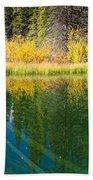 Fall Sky Mirrored On Calm Clear Taiga Wetland Pond Beach Towel
