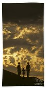 Family On Hillside Holding Hands And Facing Life Together. Beach Towel