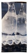 Fat Twin Icicles Over Water Surface Beach Towel